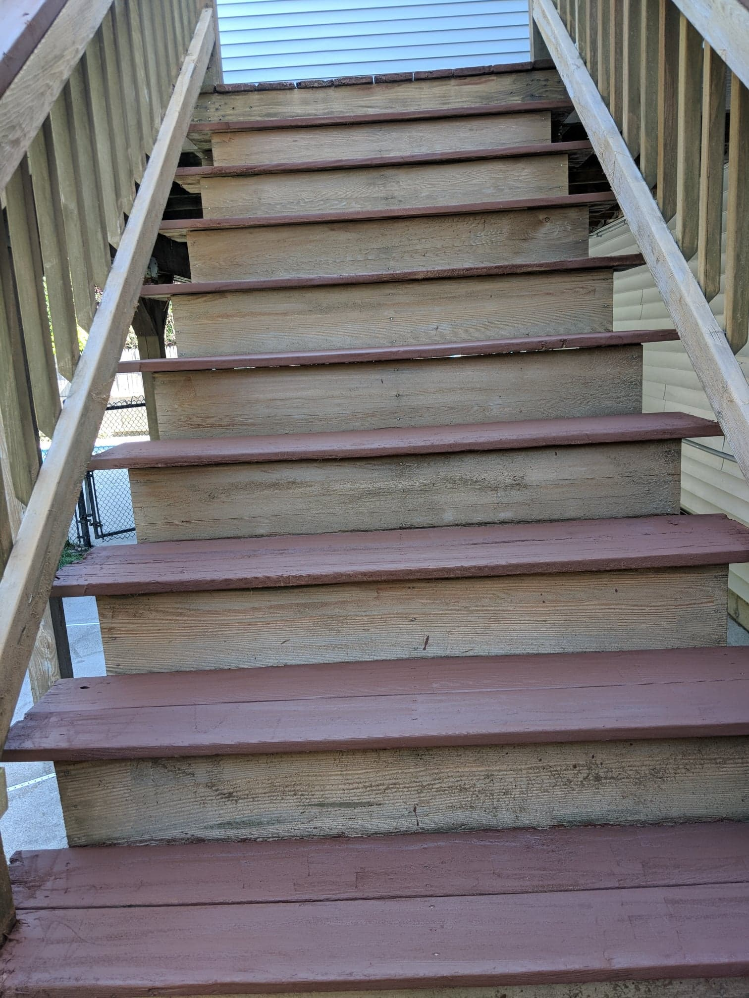 handyman services repairing a deck and stairs with re-staining
